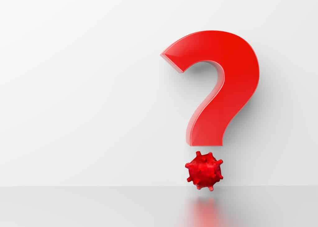 Fragezeichen auf weißen Hintergrund, wobei der Punkt des Fragezeichens einem Virus-Symbol gleicht