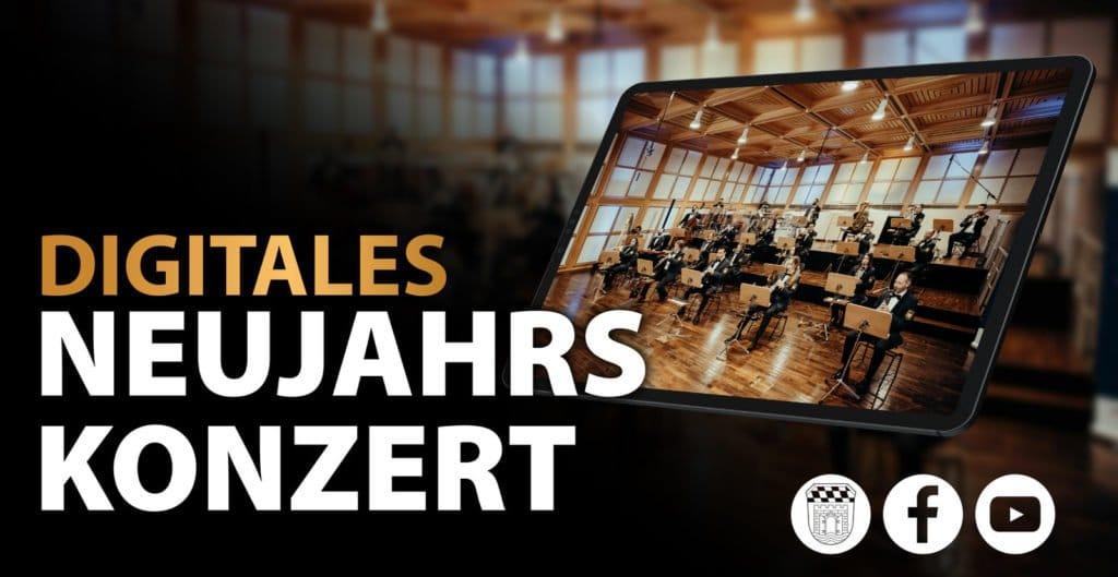 Polizeiorchester Bayern spielt in einem Saal. Gesehen wird das durch ein Tablet im Vordergrund, welches den digitalen Aspekt des Konzerts hervorheben soll